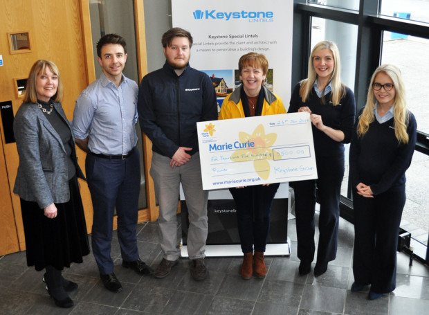 keystone group present cheque to marie curie charity